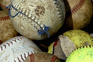 A Close up of tattered baseballs and softballs