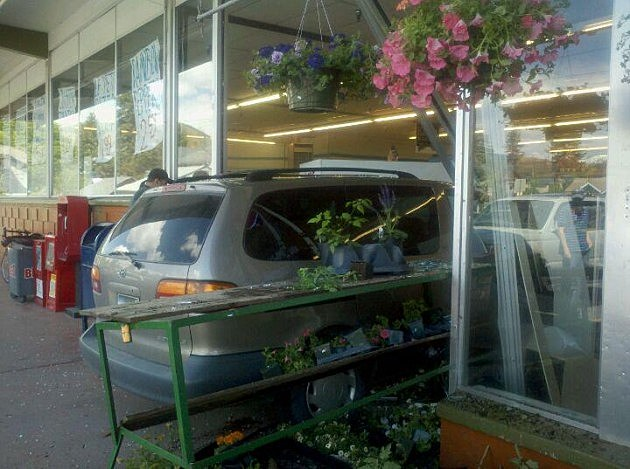 Car Crashes Through Food Farm Window