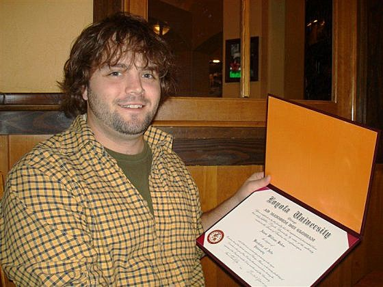 Adam with diploma