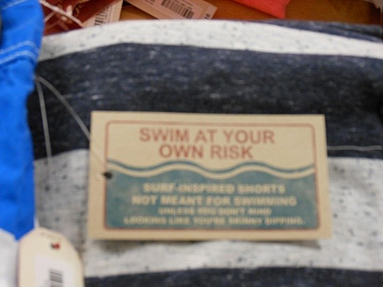 SWIM AT YOUR OWN RISK tag