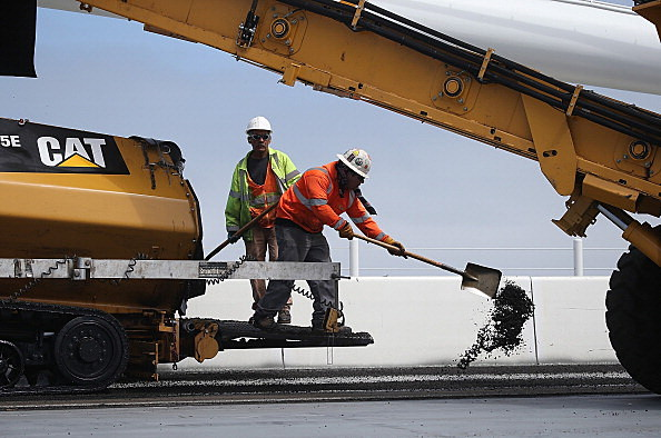 Workers Pave SF-Oakland Bay Bridge As Delays Continue