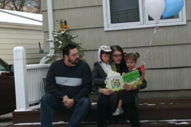 "Photo Courtesy of Missoula United Way ""Matt (dad), Petrea (mom), Tallis (4-year-old boy on the left) & Luna Parkey (2-year-old girl on right)"""